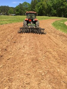 An AMCO LTF with optional feathering blades preps Russ Berry's garden for spring planting.