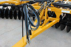 AMCO F15B Folding Disc Harrow - hydraulic hoses over tongue