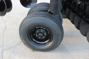 AMCO F15B Folding Disc Harrow - close up of wheels
